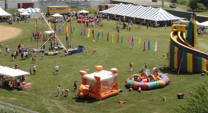 aerial of the field with a tiger bounce house
