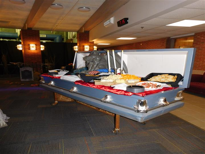 catering food served in a coffin with a gargoyle