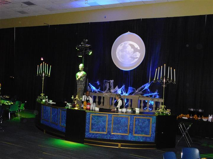halloween catering event theme  with mummies and candlesticks and cobwebs