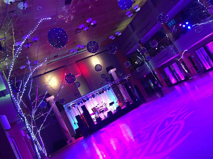 dance floor lite up with ornaments hanging from the ceiling