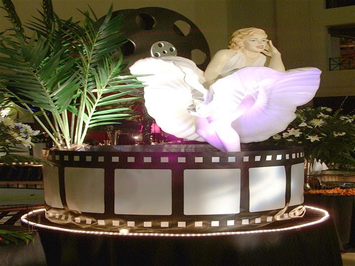 marilyn monroe figure with her skirt blown up on  a film wheel
