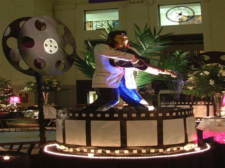 Elvis figurine on a film wheel for Hollywood themse