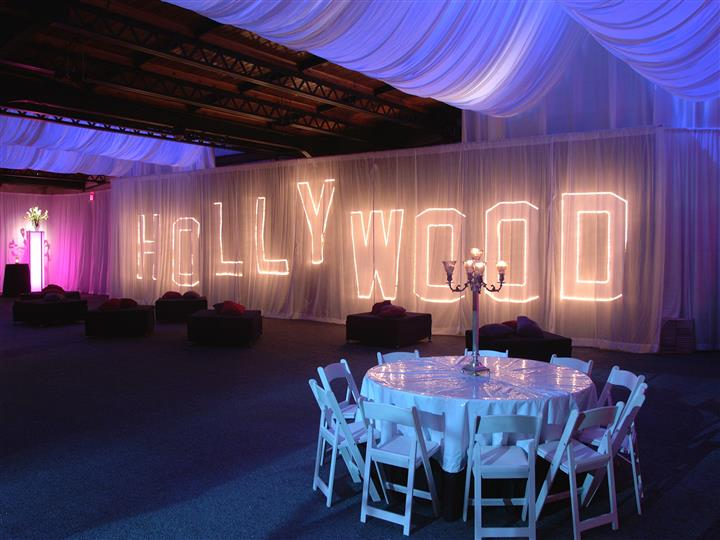 hollywood lite up screen with candlestick center pieces