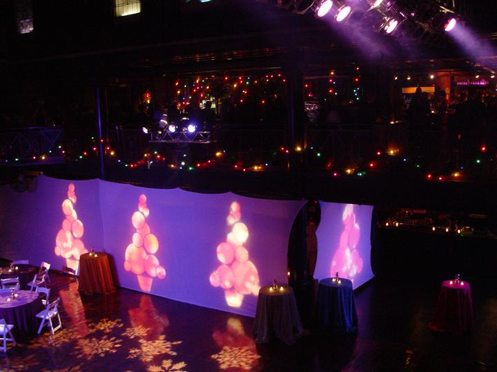 christmas winter wonderland decor with ornaments projected on a screen