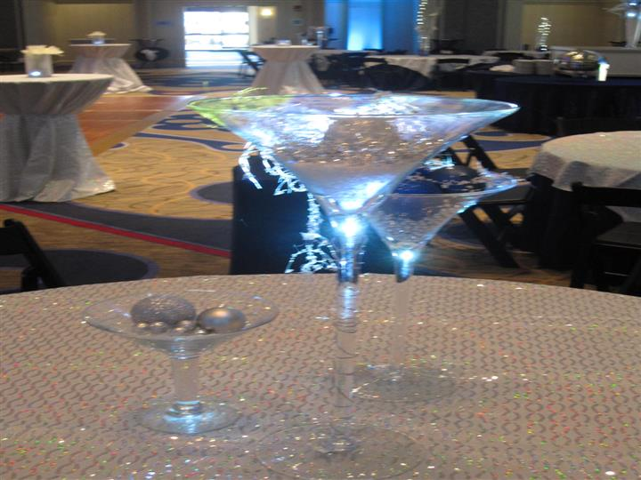 Martini glasses centerpieces with silver balls and tinsel