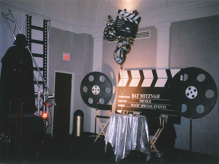 movie clap board with balloons and film props