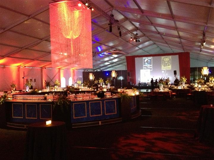 inside an event hall with floaral enterpieces