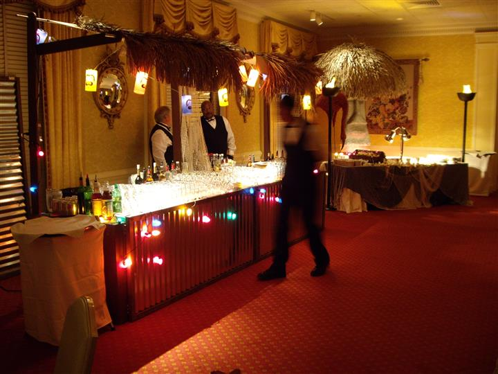 bar area with christmas lights and waiters