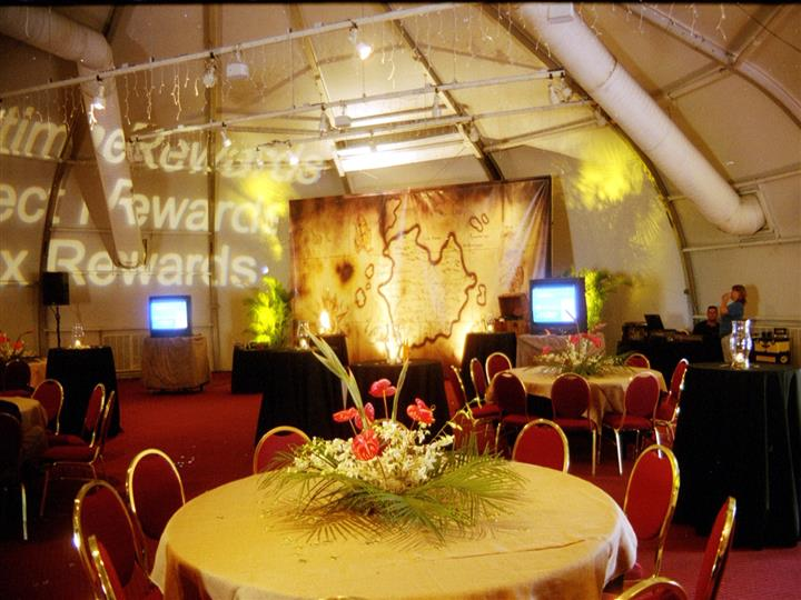 treasure map theme event venue with red chairs