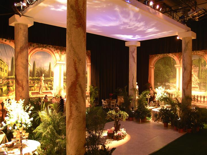 greenery inside a venue with clouds projected on the ceiling
