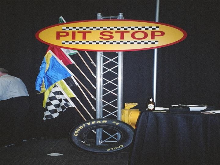 pit stop of flags and wheels