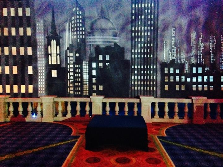 inside a venue with carpets and a skyline picture