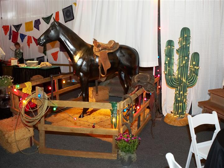 horse with saddle and cactus