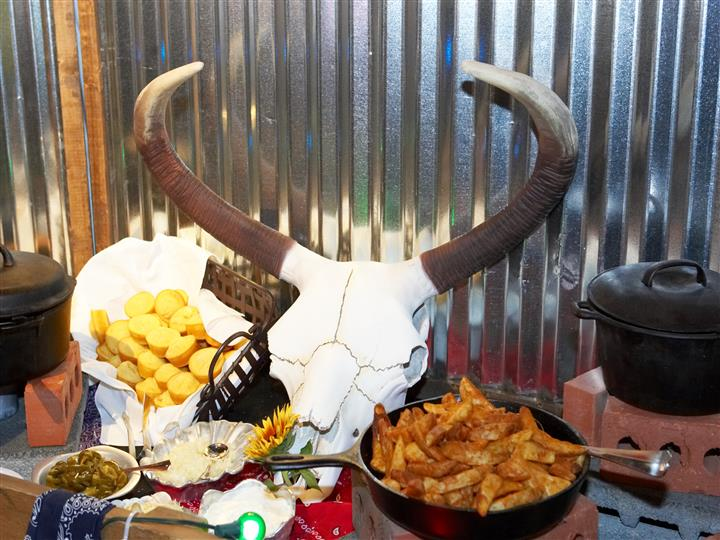 bull skull with fires and corn bread on the table