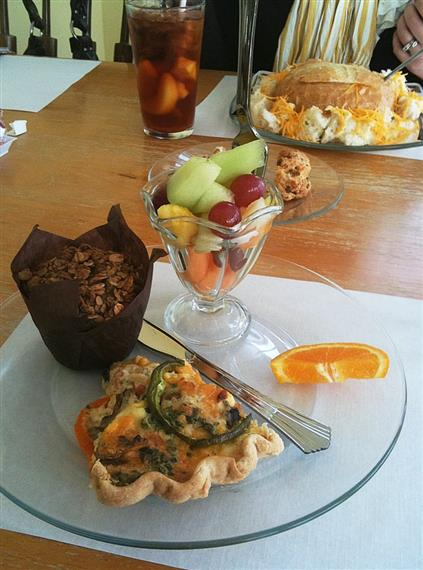 fruit cup with a muffin and a variety of breakfast items