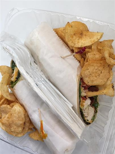 Chicken wrap served with chips