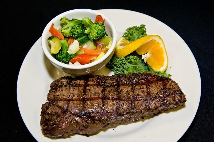 steak with a side of mixed vegetables