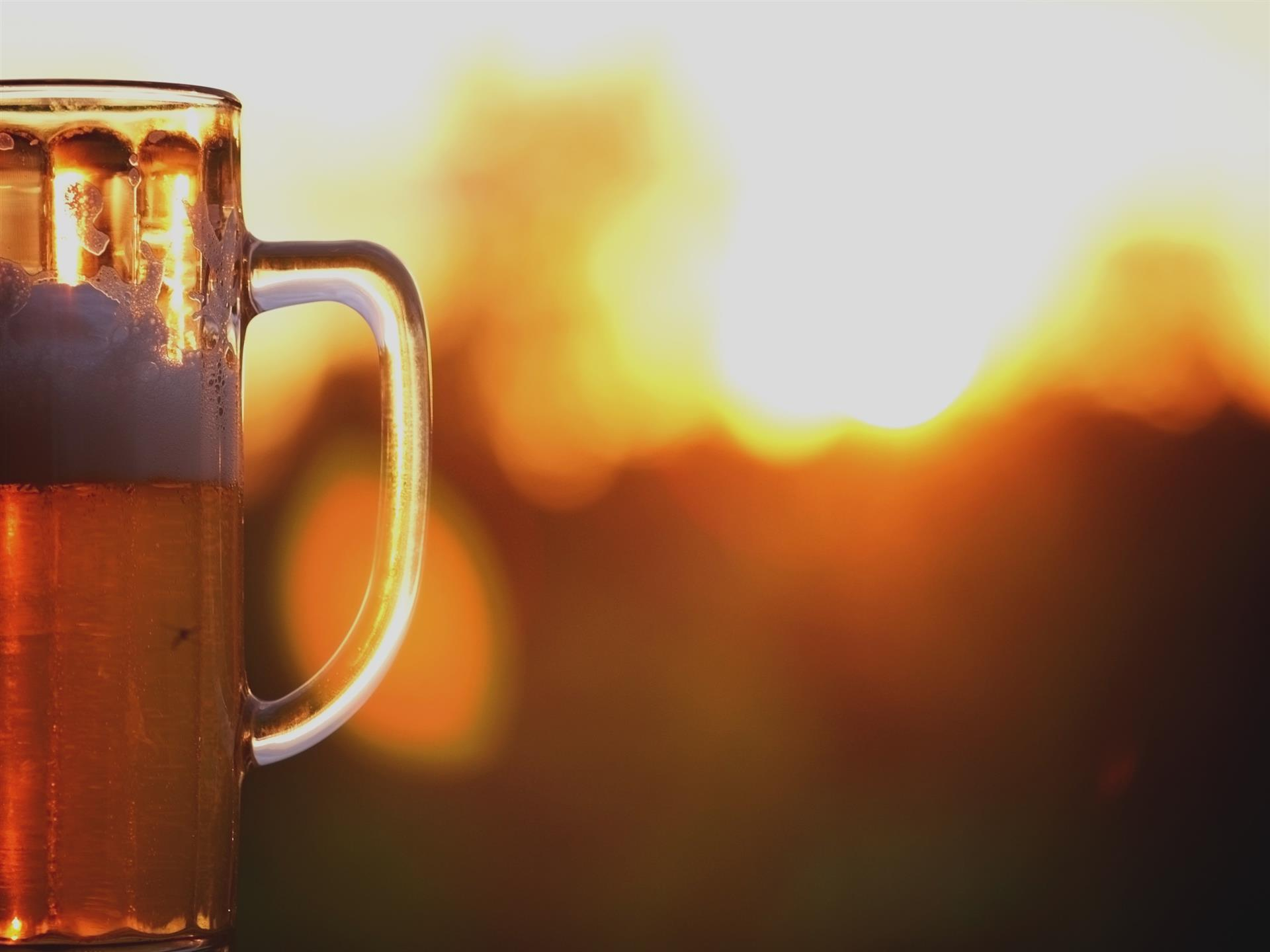 pitcher of beer with the sunset