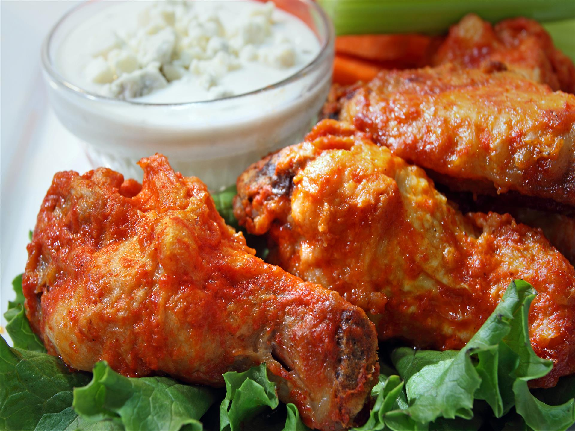 three buffalo wings with dipping sauce