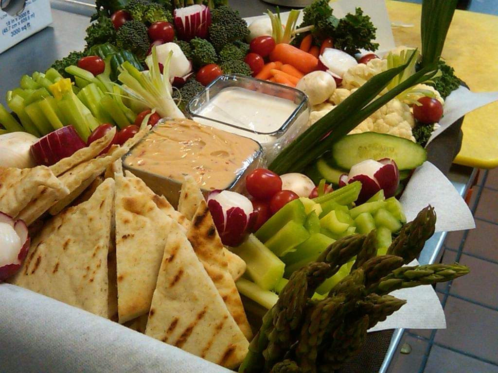 various dips and vegetables on platter