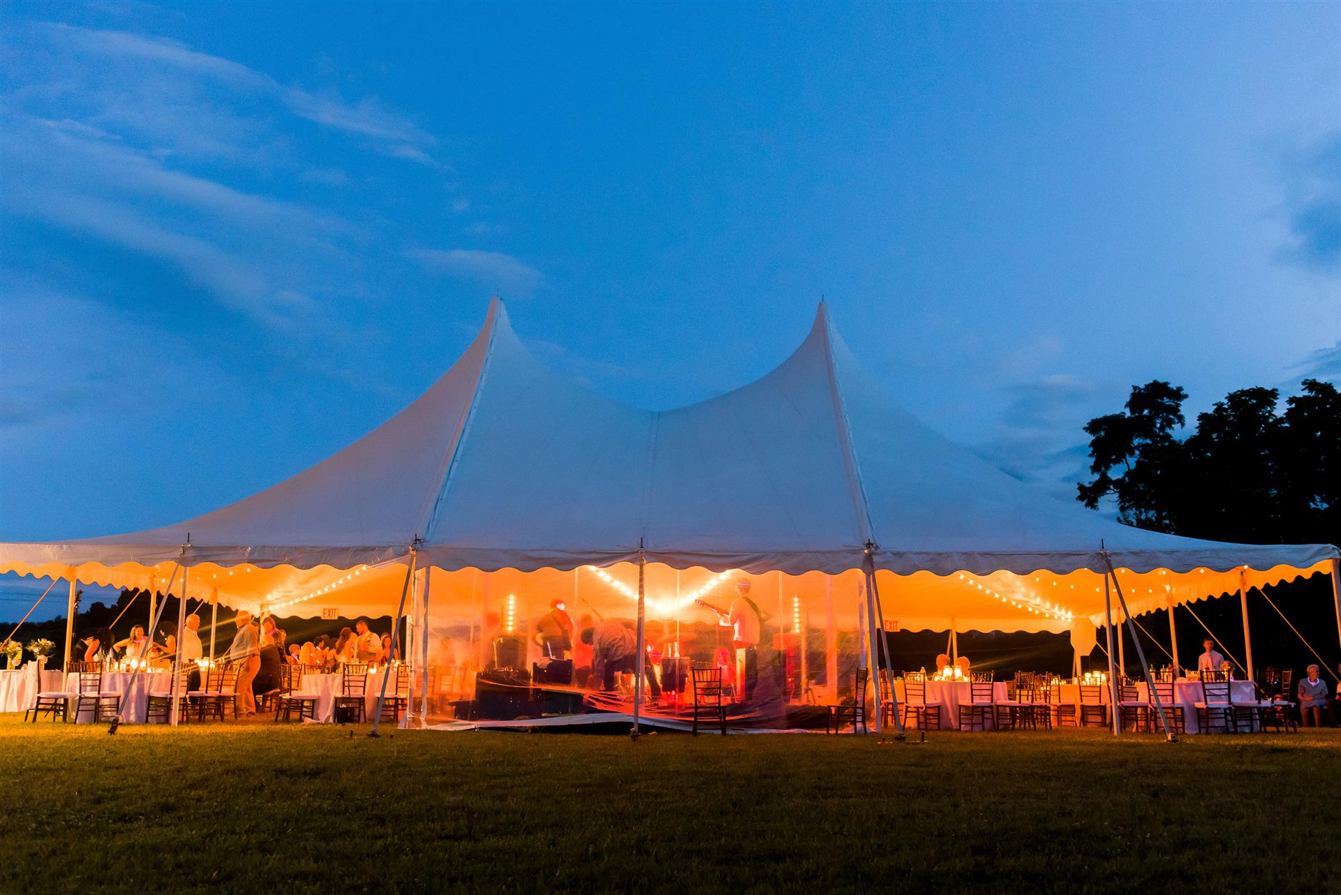 outdoor tent set up with lights on