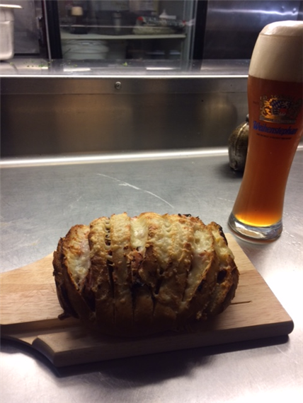 bread and beer in a glass