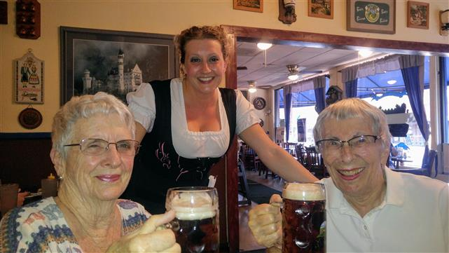 females holding mugs of beer