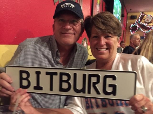 male and female hold a bitburg sign