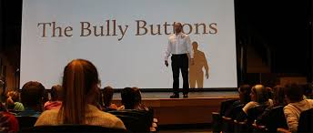 the bully buttons presentation in front of an audience