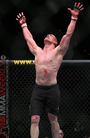 Tom murphy celebrating in ring after winning M M A fight