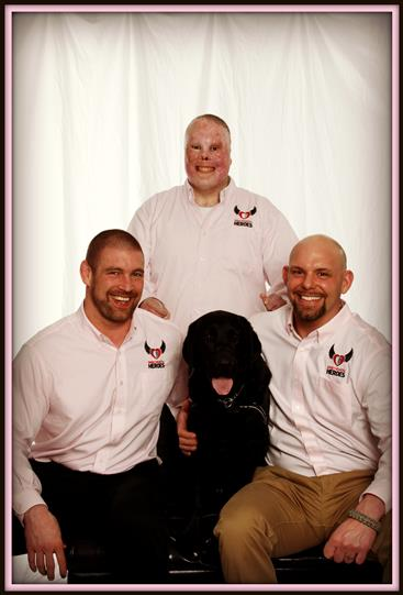 Tom murphy, rick yarosh, jason spector pose with dog for photo