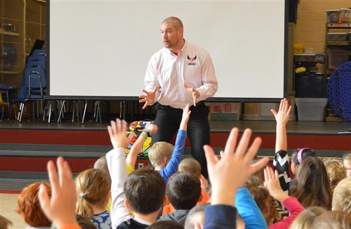 Tom murphy speaking in front of elementary students