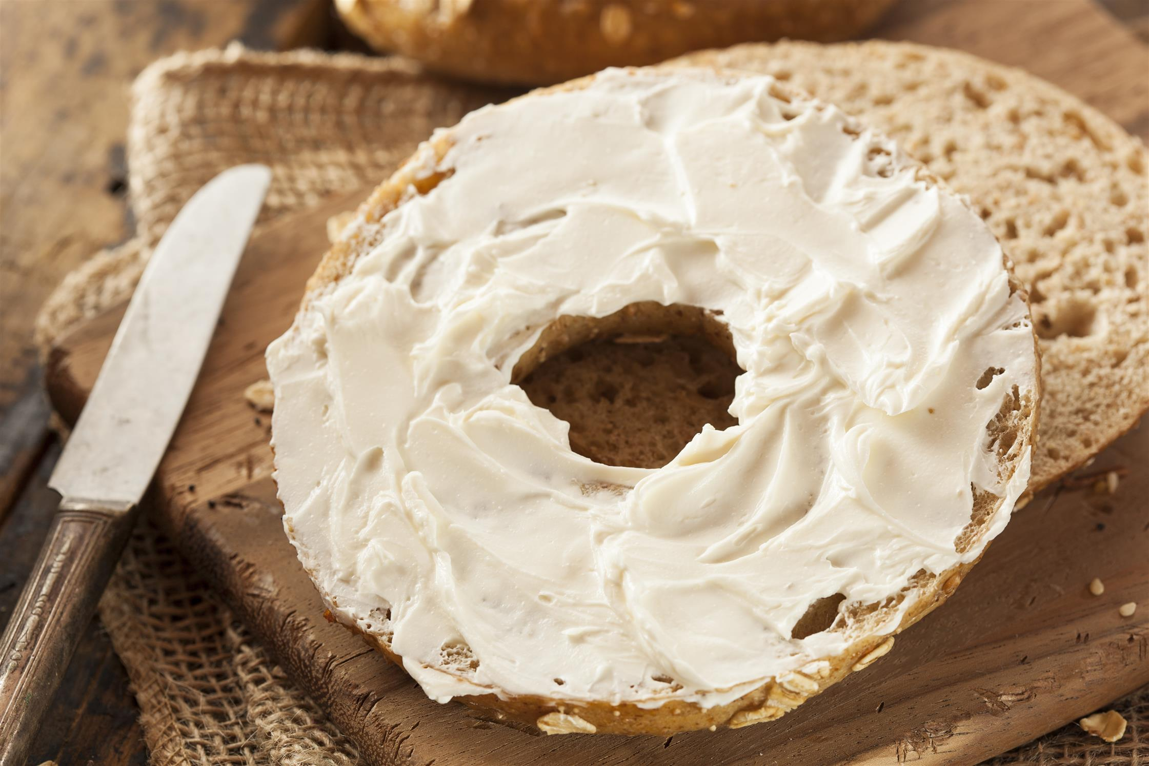 bagel with cream cheese on top