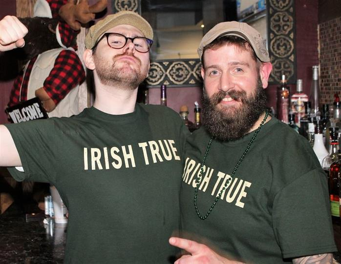 two males in picture, both are wearing irish true t-shirts