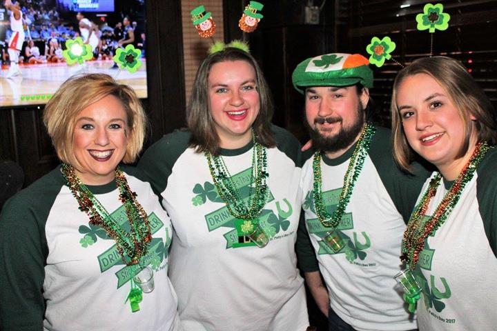 four people dressed up for st. patrick's day