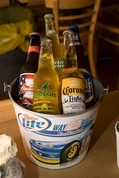bucket filled with bottles of beer over ice