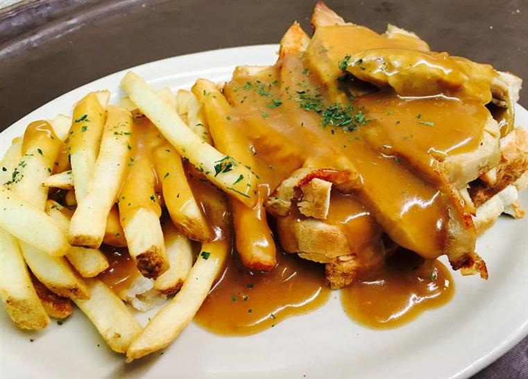 sliced meat with gravy and fries