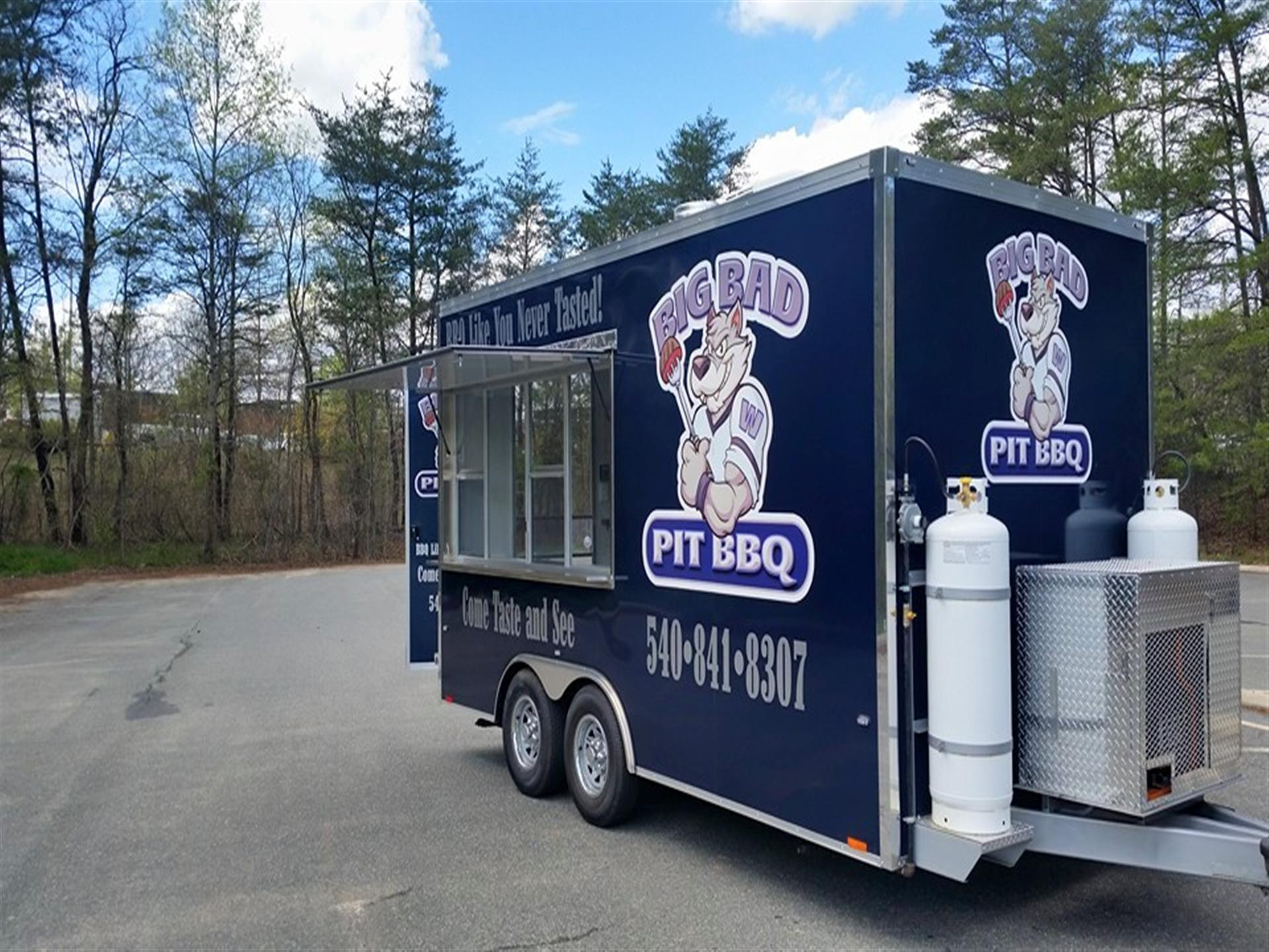 Big Bad Pit BBQ truck in parking lot. 840-841-8307