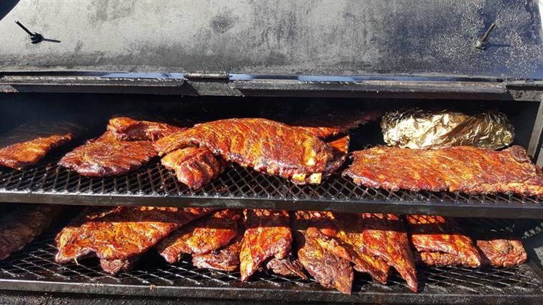 Racks of ribs on smokers