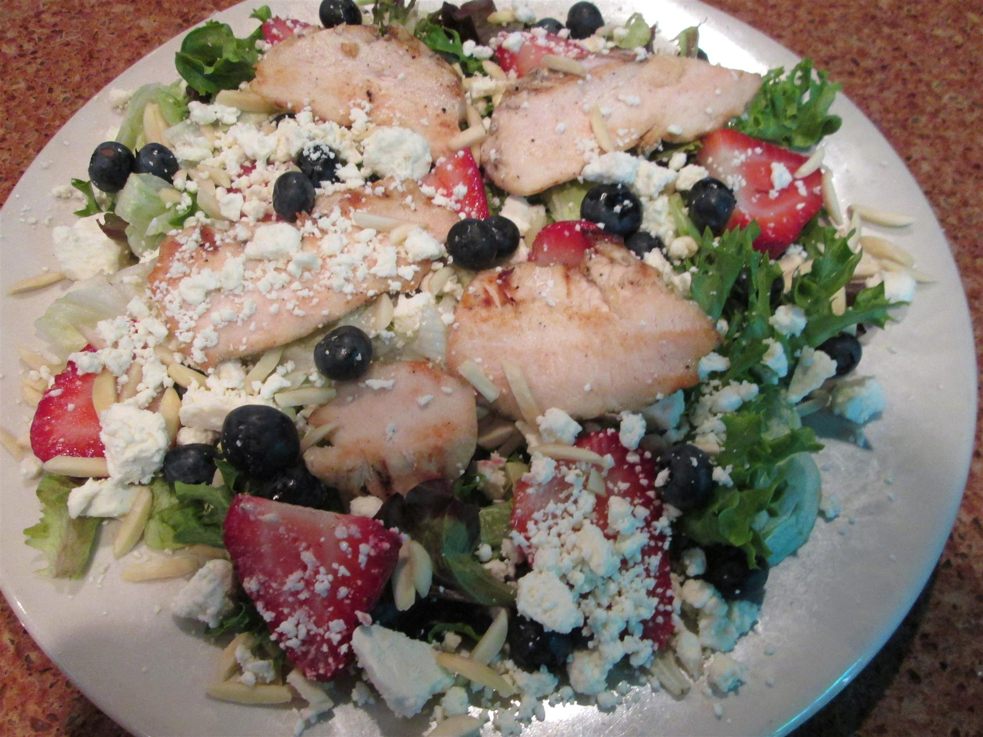 salad with chicken, feta, blueberries, strawberries