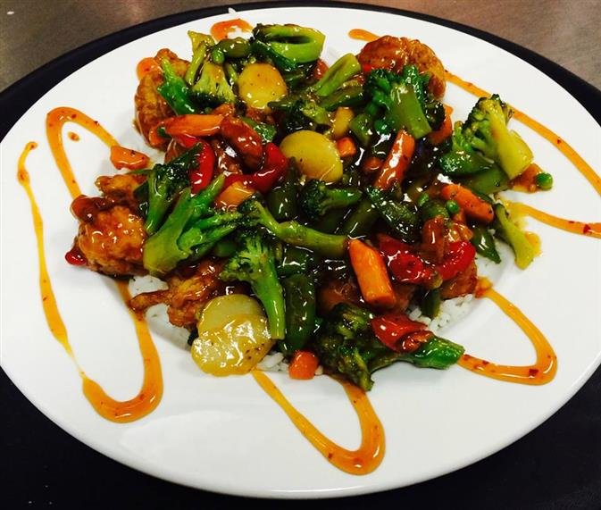 asian stir fry bowl. Grilled strips of chicken, mixed Asian vegetables, served over a bed of steamed white rice tossed with your choice of Teriyaki or General Tso sauce.