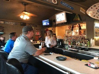 Bartender talking to customers