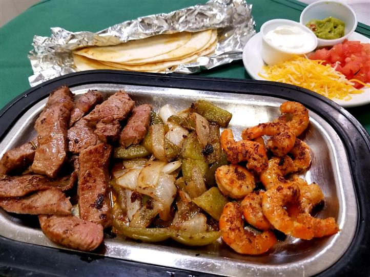 Beef and shrimp on a platter