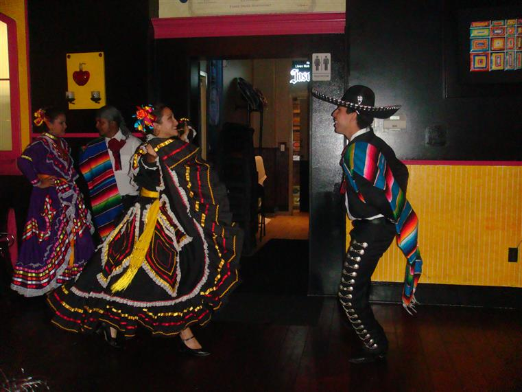 couple dancing in mexican outfits