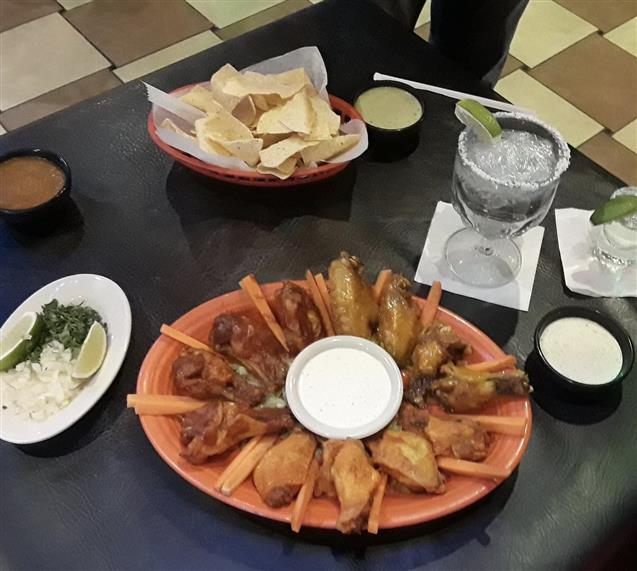 Wings, chips, tequila shot with lime, margarita