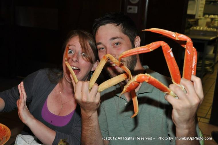 male holding crab legs
