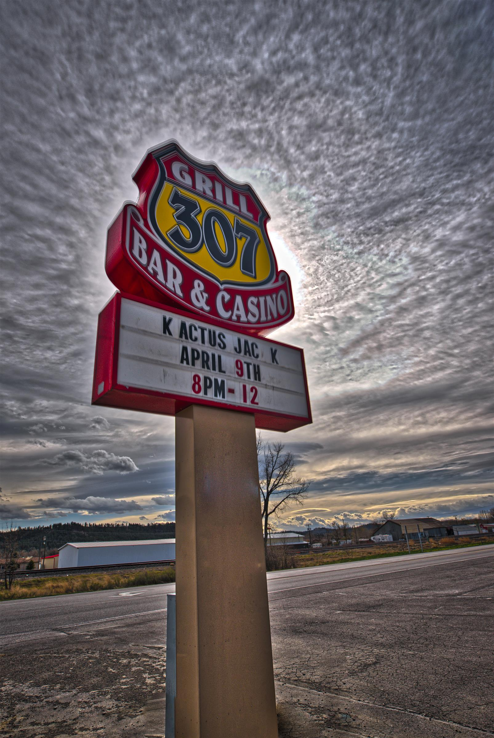 307 Bar & Grill sign outside with landscape in the background