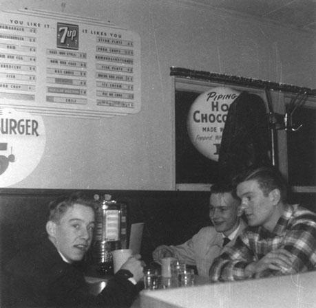 vintage photo of three men sitting at a table