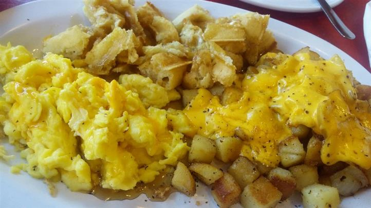 scrambled eggs, cut up waffles and homefries