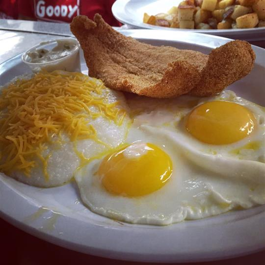 Two eggs sunny side up with a side of cheese grits